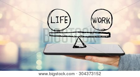 Life And Work Balance With Man Holding A Tablet Computer