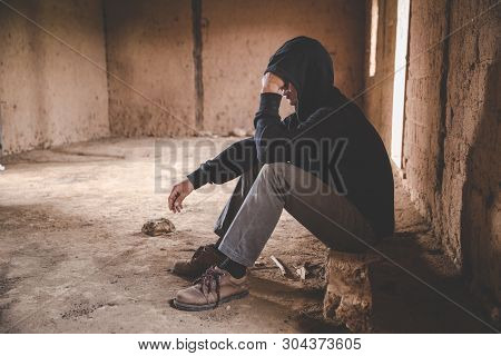 Men Who Show Stress And Loneliness, Homeless Man Drug  Addict Sitting Alone And Depressed  At An Aba