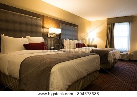 Interior View Of A Twin Queen Bed Hotel Room