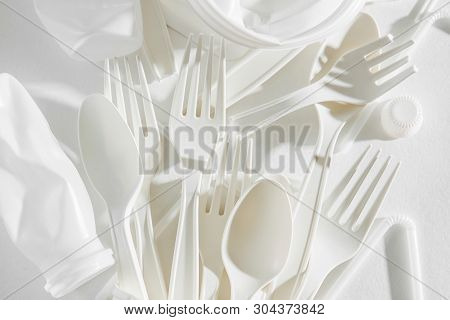 White Single Use Plastic On  White Background. Closeup.  Concept Of Recycling Plastic And Ecology. F