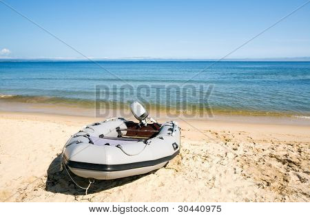 Inflatable boat on seacoast.Summer