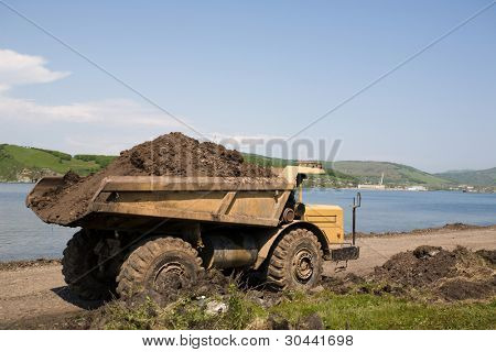 dump truck on a background of the sea