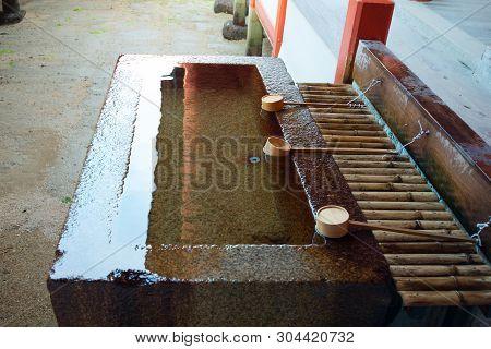 hand wash pavilion at  Itsukushima Shrine at Miyajima island Hiroshima, Japan poster