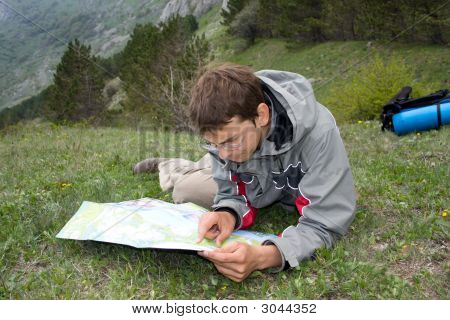 Hiker Man Looking To The Map