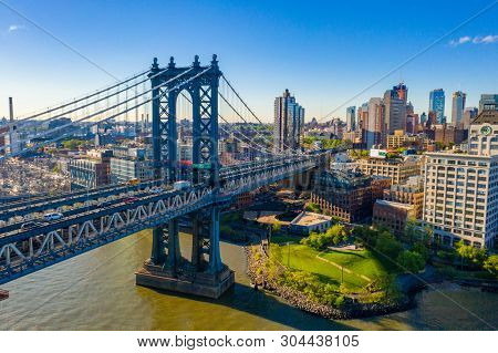 New York, New York, Usa Skyline With Brooklyn And Washington Bridges Near The Manhattan Island.