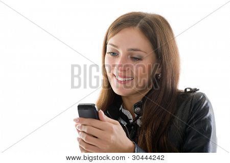 Beautiful girl in black leather jacket and a mobile phone in his hand.