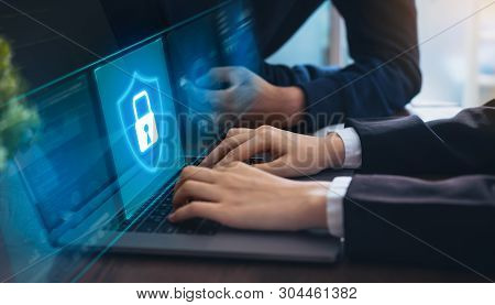 Technology Concept With Cyber Security Internet And Networking, Businessman Hand Working On Laptop,