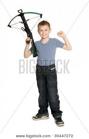 Joyful boy holding a crossbow for children.
