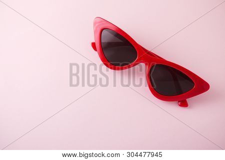 Red Retro Sunglasses On Pink Background