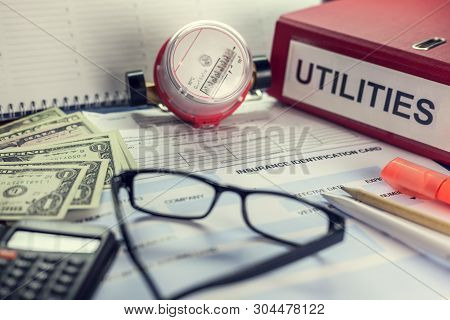Payment Of Utilities For Electricity And Water: Receipt, Bills And A Calculator. On The Folder The I