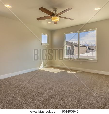 Square Frame Empty Room Of A New House With Beige Wall Paint And Carpeted Floor