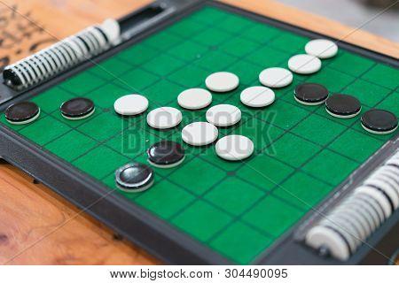 Closeup Discs On Green Reversi Board (othello),strategy Business Concept.