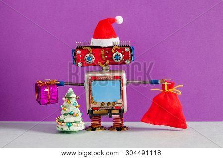 Happy Santa Claus Robot With A Bag Of Gifts. Christmas New Year Greeting Card Mockup Smiley Robotic