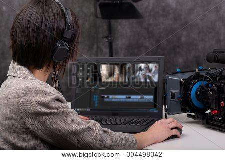 Pretty Young Woman Video Editor Working In Studio