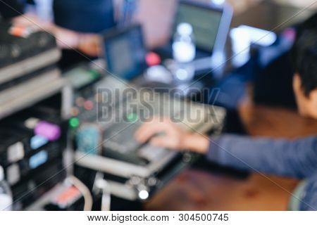 Out Of Focus A Music Mixer In Studio, Mixing Table With Buttons And Volume Controls. Stock Photo Blu