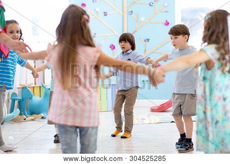 Little Children Roundelay On Lesson In Kindergarten