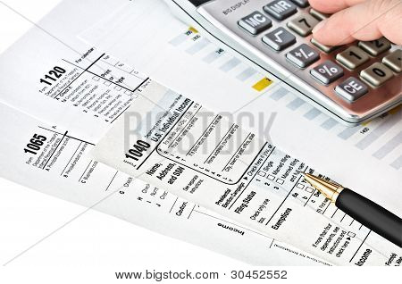Tax Forms With Pen, Calculator.