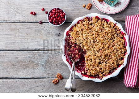 Cranberry Crumble, Crisp In A Baking Dish. Wooden Background. Top View. Copy Space