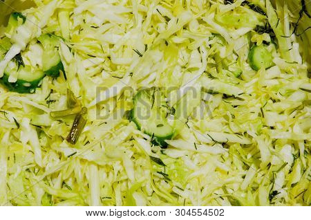 Juicy Salad Consists Of Sliced cabbage, Cucumber And Spices.