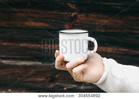 Close Up Of Man Travelers Hand Holding Metal Mug With Hot Drink. Outdoor Tea, Coffee Relax Time. Moc