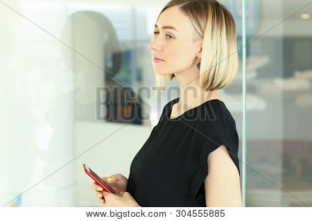 Portrait Of Pretty Woman Looking Away Confidently With Calmness. Beautiful Corporate Woman Standing