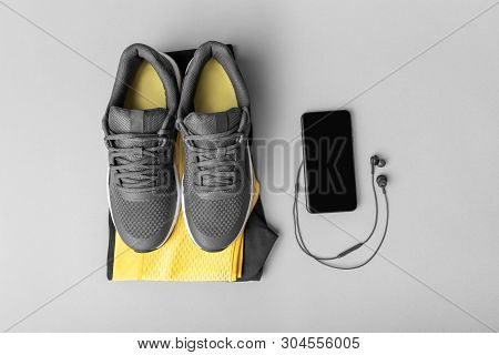 Sneakers Sportswear And Accessories On A Gray Background.