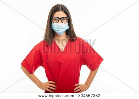 Portrait Of Beautiful Young Nurse Wearing Scrubs And Face Sterile Mask