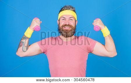 Man Bearded Athlete Exercising Dumbbell. Motivated Athlete Guy. Athlete On Way To Stronger Body. Hea