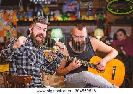 Cheerful Friends Sing Song Guitar Music. Relaxation In Pub. Friends Relaxing In Pub. Live Music Conc