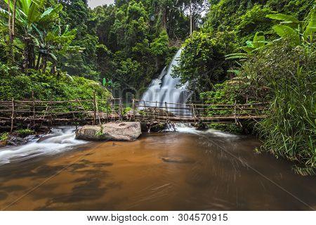 Motion Blurred Water Of Pa Dok Siew Waterfall (rak Jung Waterfall ) Beautiful Waterfall In Deep Fore