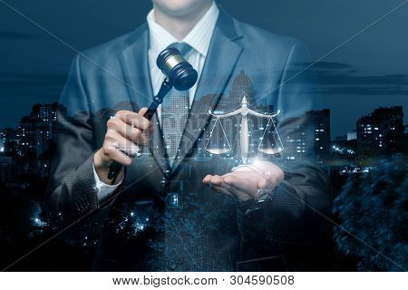 The Lawyer Shows The Scales Of Justice Against The Background Of The Night City.