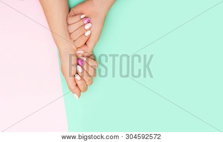 Top View Of Perfect Manicure With Trendy Nail Art On Pink And Turqoise Background With Copy Space