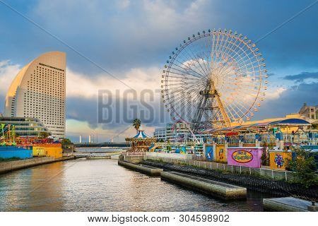 Yokohama, Japan - April 2: Cosmo World Amusement Park With Cosmo Clock 21 In Yokohama At Sunset, One