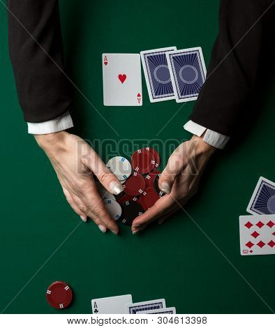 Top View Of A Poker Table During A Game.  Chips And Cards On The Table.
