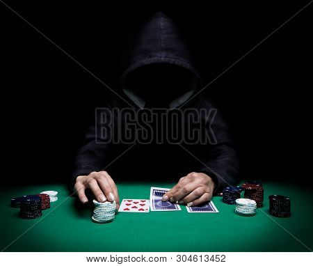 Unknown Woman Playing Poker On Green Table With Chips All Around, Front View