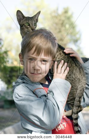 Blond Boy With Oriental Bred Cat