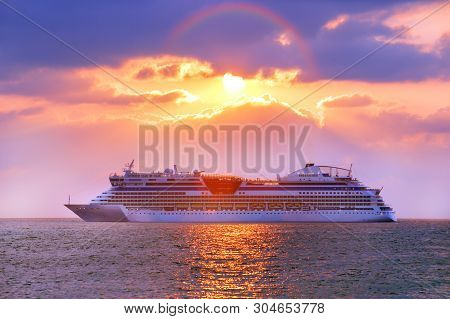 Luxury Cruise Ship. Beautiful Seascape Sunset Background. Romantic And Luxury Travel Concept.
