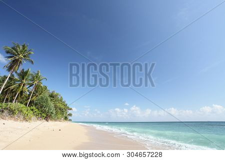 Tropical Sunset On The Beach With Blue Sky
