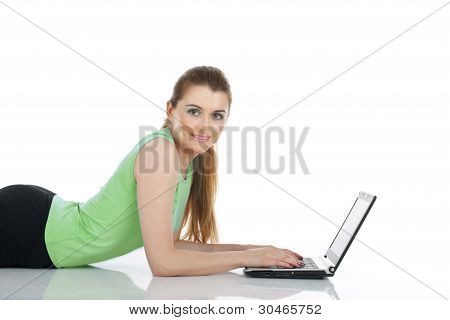 Happy Young Woman Using Computer