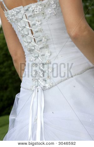 The back of a brides wedding dress poster
