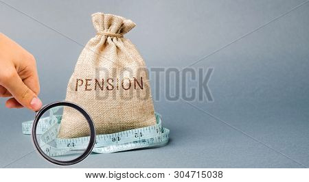 Money Bag With The Word Pension And Tape Measure. Fall / Reduction Pension Payments. Retirement. Fin