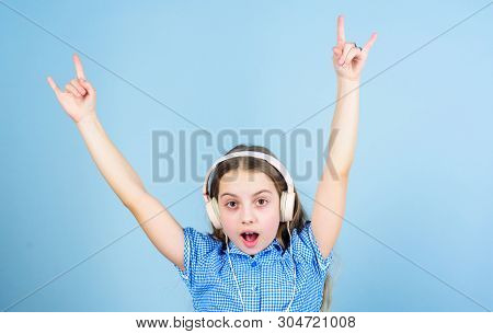 Shes A Rock Star. Little Kid Showing Horn Hand Gesture Like A Hard Rock Or Heavy Metal Fan. Cute Sma