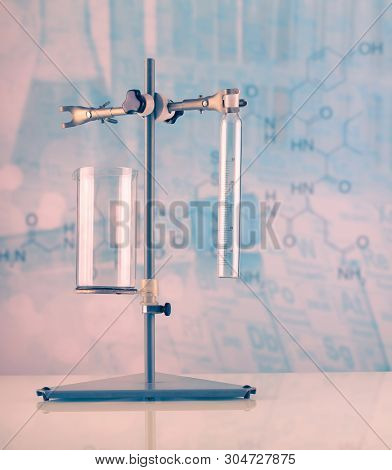 Laboratory Stand With A Variety Of Flasks And Vessels On A Light Blue Background