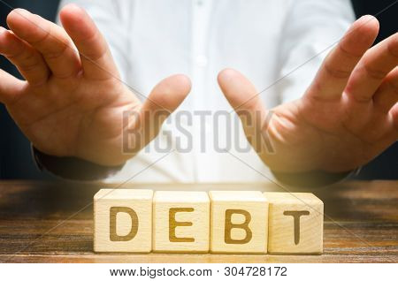 A Businessman Is Fenced Off From Debt. Inability To Pay The Debt, Economic Difficulties. Unfavorable