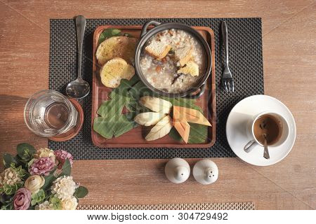 Breakfast Set Consists Of Mushroom Soup, Bread And Fruit.