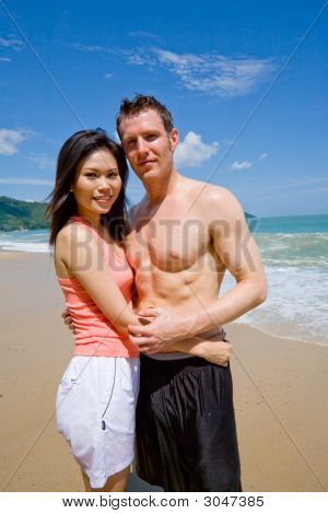 Young Couple By The Beach
