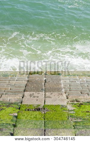 Stone Seaside Quay Steps In Symmetry With The Ocean