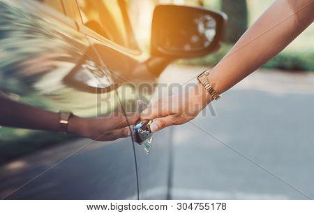 Close Up Hands Woman Using Systems Key Near Car For Lock,unlock Of Blue Hatchback Car Near Street Ro