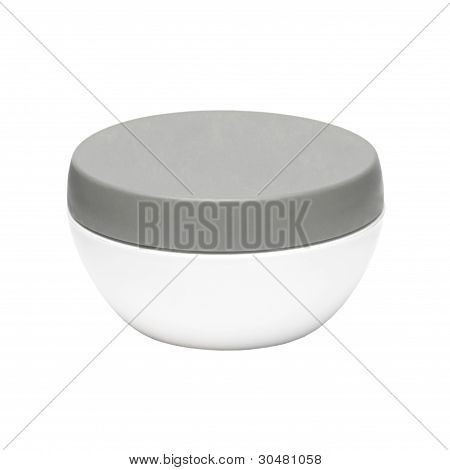 White Plastic Jar With A Dark Cap