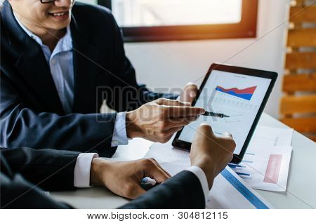 Two Partner Business Man Investor Talking About Financial Statistics Chart Information In Mobile Tab